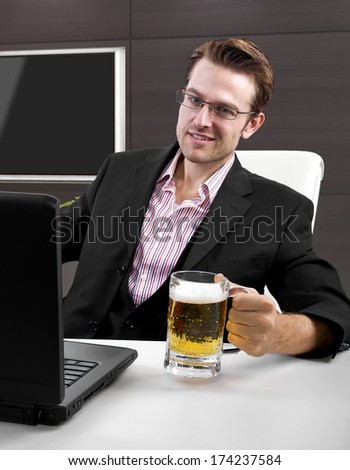 Caucasian businessman working with a laptop in an office