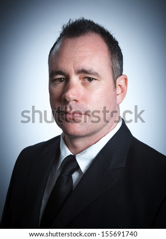 Caucasian businessman 40 years old isolated on a grey background - stock photo