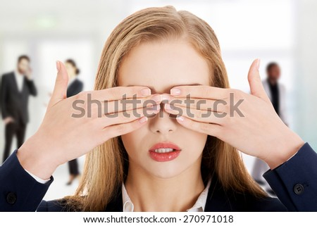 Caucasian businesswoman covering eyes with hands. - stock photo