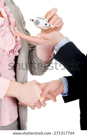 Caucasian businesswoman giving a plane to her partner. - stock photo