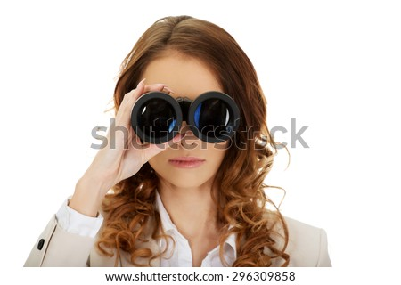 Caucasian businesswoman looking through binoculars. - stock photo