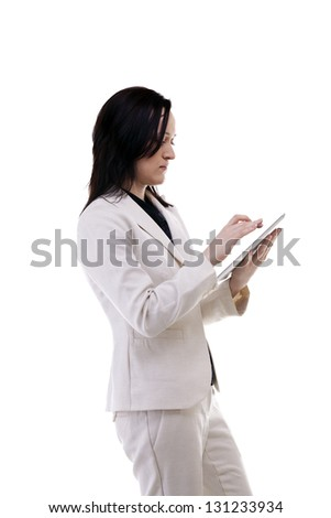 Caucasian businesswoman working on a digital tablet isolated on white background studio shot