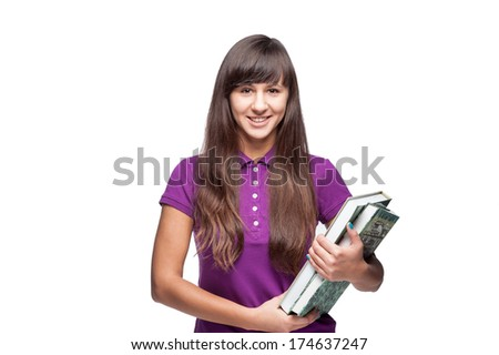 caucasian casual smiling girl holding books isolated on white