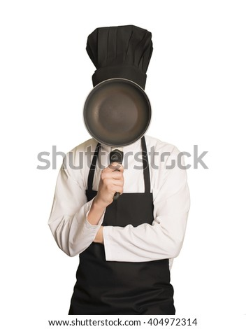 Caucasian chef boy Covering his face with a cooking pan - stock photo