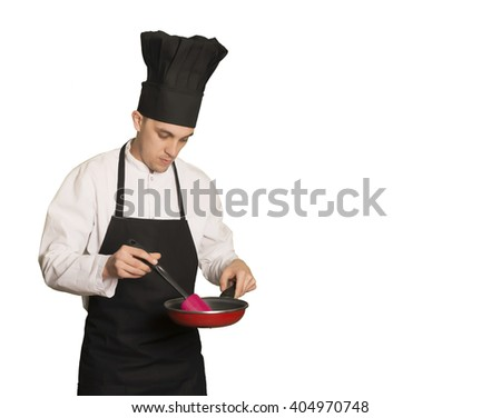 Caucasian chef boy with a cooking shovel  and pan - stock photo