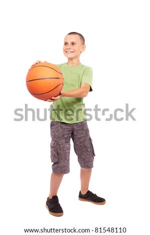 Caucasian Child playing basketball, isolated on white background - stock photo