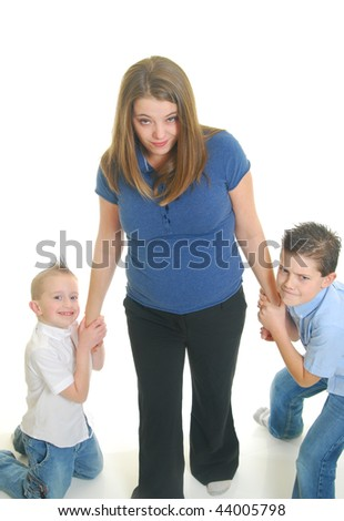 Caucasian children pulling on mother, isolated on white. - stock photo