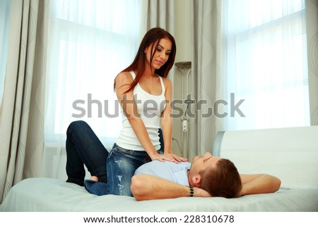 Caucasian couple in love on the bed - stock photo