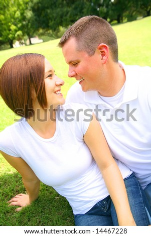 caucasian couple look at each other. concept for young family