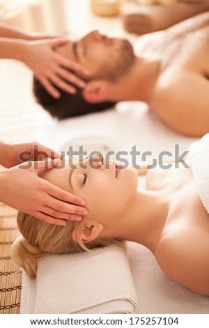 Caucasian couple on a head massage. - stock photo