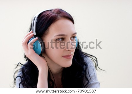 Caucasian dark haired woman with earphones - stock photo