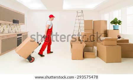 caucasian deliveryman in red uniform holding hand truck, delivering boxes to new house - stock photo