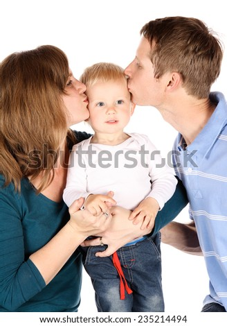 Caucasian family with mom dad and baby boy. The parents are kissing their son. Image is isolated on a white background. - stock photo