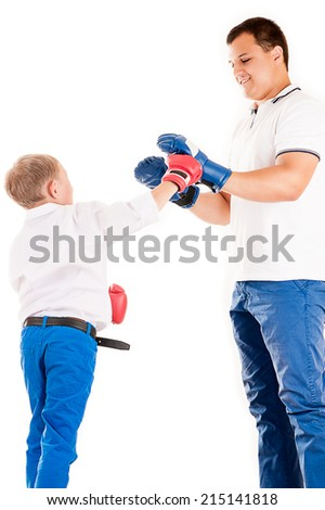 Caucasian father of boxing with son - stock photo