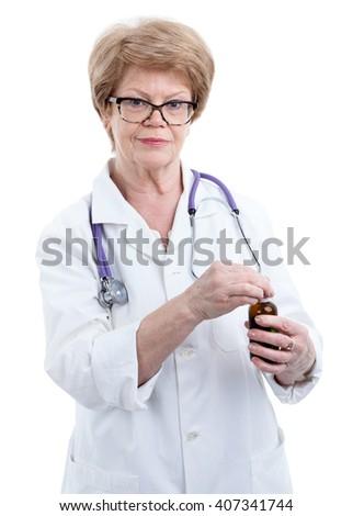 Caucasian female doctor in eyeglasses opening drug bottle, isolated on white background - stock photo