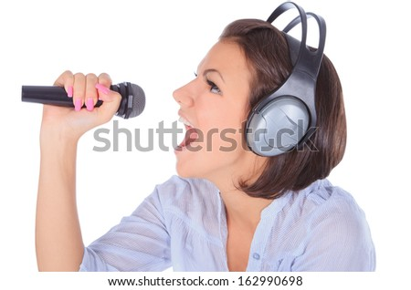 Caucasian female singing in to microphone. - stock photo