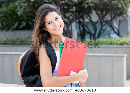 Caucasian female student looking at camera - stock photo