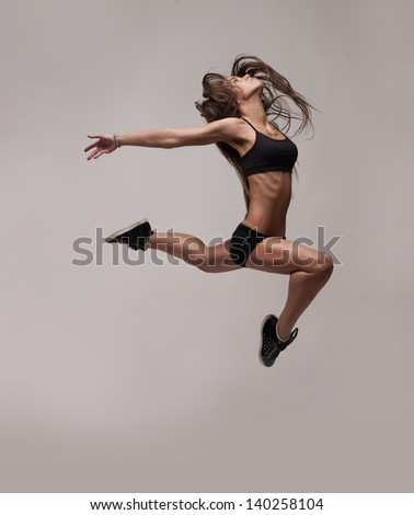 caucasian fitness woman jumping isolated on white background - stock photo
