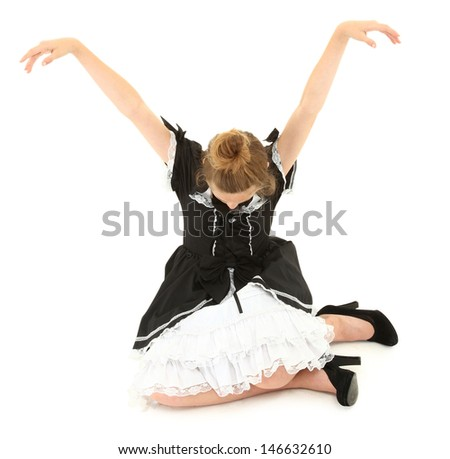 Caucasian Girl Child Sitting in Marionette Pose in Lolita Fashion Dress. Arm up, head down. - stock photo