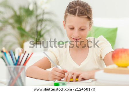 Caucasian girl doing homework after school.