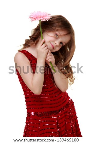 Caucasian girl in a beautiful dress holding a pink gerber on a white background on Holiday - stock photo