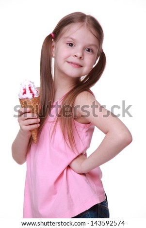 Caucasian girl wearing blue jeans shorts and pink T-shirt on Beauty and Fashion theme/European young model with funny two tails and holding sweet ice-cream - stock photo