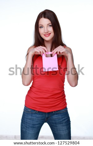 Caucasian girl with long dark hair holding pink box on Holidays