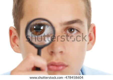 Caucasian guy looking through a magnifying glass, with fish eye lens, isolated on white