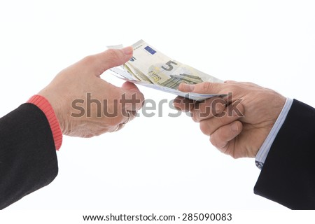 Caucasian hand holding a wad of euros for payment, isolated on white