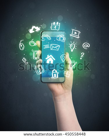 Caucasian hand in business suit holding a smartphonea - stock photo