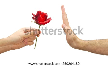 Caucasian hand refuses a flower or declines a gift isolated on white background