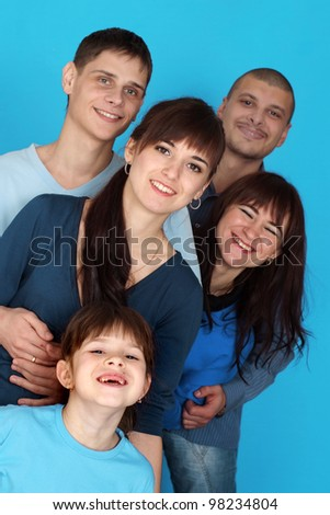Caucasian happy  beautiful family consisting of five people together on a blue background