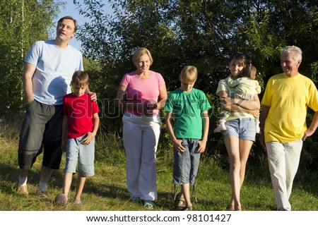 Caucasian happy nice family of seven is on the path to the nature