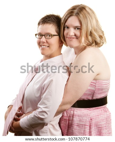 Caucasian lesbian couple embracing over white background - stock photo