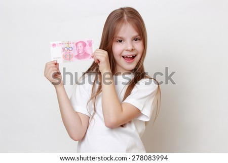 Caucasian little girl holding Chinese yen - stock photo