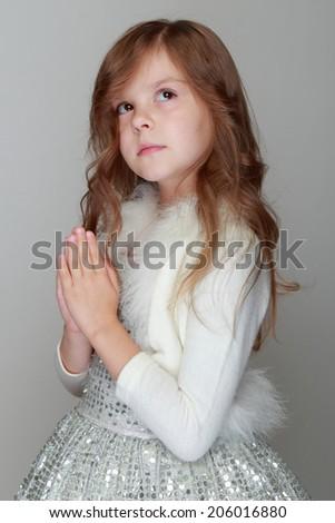 Caucasian little girl portrait sad  on grey background - stock photo