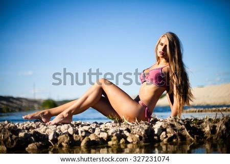 Caucasian long hair model posing in bikini. - stock photo