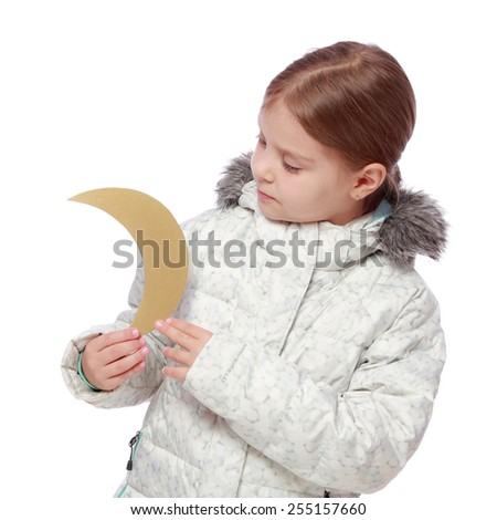 Caucasian lovely little girl in a white winter down jacket keeps the moon on a white background - stock photo
