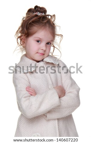 Caucasian lovely little girl wearing stylish coat on Beauty and Fashion theme/Happy young girl with nice hairstyle on Holiday theme