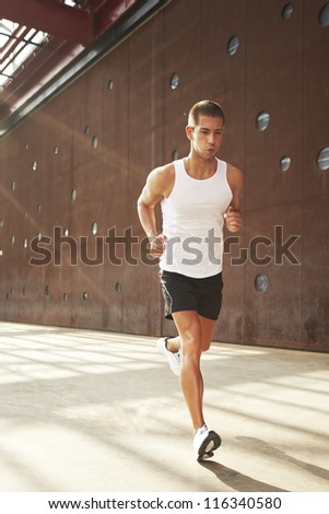 Caucasian male athlete doing exercise outdoor - stock photo