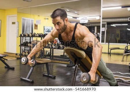 Caucasian male bodybuilder in gym