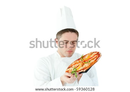 Caucasian male cook holding a pizza against white background - stock photo