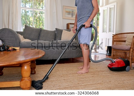 Caucasian male doing domestic chores at home - stock photo
