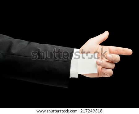 Caucasian male hand in a business suit, gesture sign, low-key lighting composition, isolated over the black background - stock photo