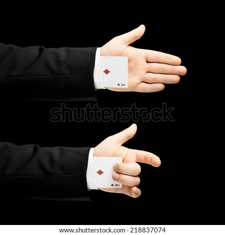 Caucasian male hand in a business suit, holding an ace playing card in the sleeve, low-key lighting composition, isolated over the black background - stock photo