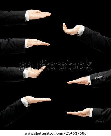 Caucasian male hand in a business suit, opened palm gesture sign in seven versions, low-key lighting composition, isolated over the black background - stock photo