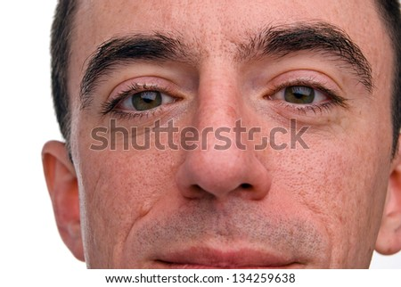 Caucasian Male Headshot - Extreme Closeup of his Nose, Eyes and Upper Lip - stock photo