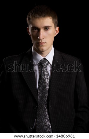 caucasian male person in business suit on black