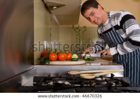 Caucasian male preparing food in home kitchen. Lifestyle - stock photo