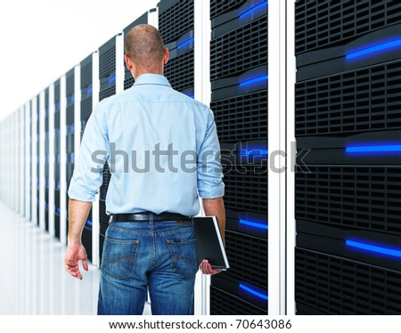 caucasian man and  datacentre with lots of server - stock photo